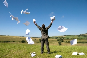 A happy businessman lets go of this paperwork! See my gallery for more.